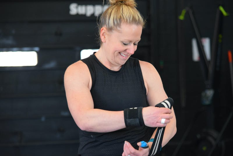 Shelburne CrossFit athlete Riley Foley wraps her wrists as she gets ready to do some weightlifting for the CrossFit Games quarterfinals.  KATHY JOHNSON   - Saltwire network