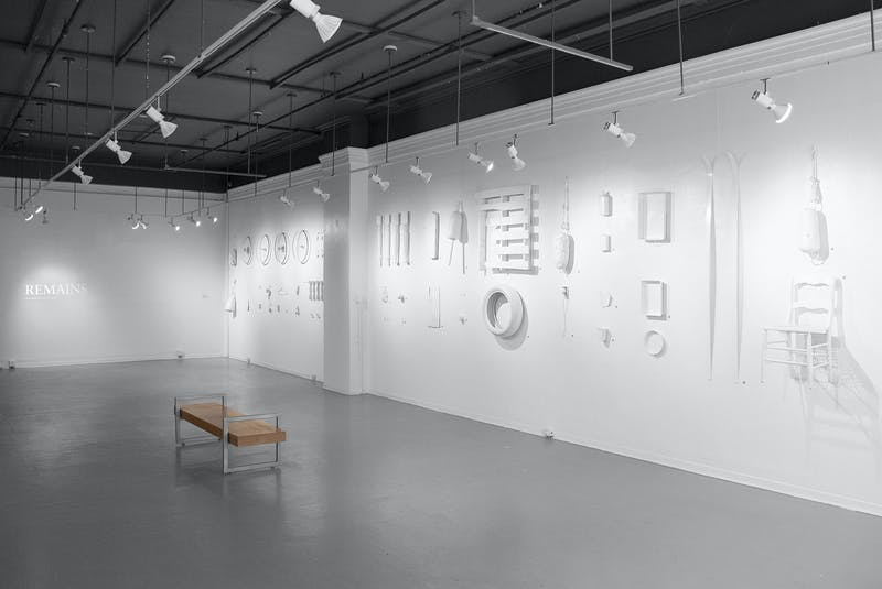 Marie-Soleil Provençal's Remains exhibit features 60 collected items of discarded trash, painted white and displayed along a single wall of the Anna Leonowens Art Gallery. - Contributed
