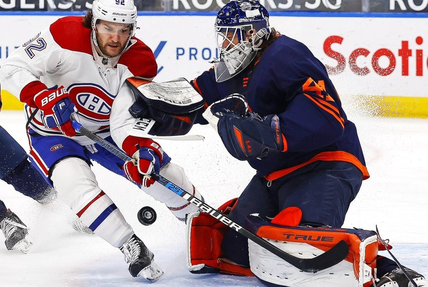 Edmonton Oilers goaltender Mike Smith (41) makes a save against Montreal Canadiens forward Jonathan Drouin (92) during the second period at Rogers Place.