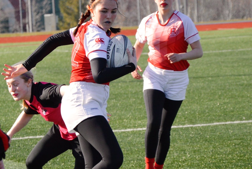 Isabella Andree of the Riverview Ravens sidesteps a tackle from a member of the Glace Bay Panthers during Cape Breton High School Rugby League girls action at the Cape Breton Health Recreation Complex turf on Wednesday. Riverview won the game 45-0. - Jeremy Fraser