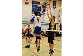 Emmett Gaudette, left, in action with the Westisle Wolverines of the P.E.I. School Athletic Association Senior AAA Boys Volleyball League. Gaudette, who is from Tignish, will join the Holland Hurricanes for the 2021-22 Atlantic Collegiate Athletic Association (ACAA) men's volleyball season.