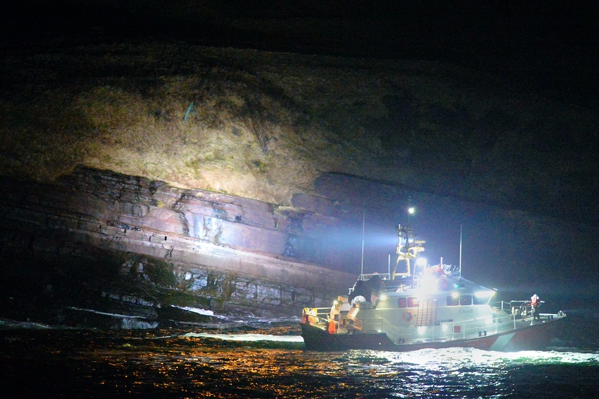 Rescue personnel search for a missing person who reportedly disappeared into the waters near the breakwater in Flatrock Wednesday night.- Keith Gosse/The Telegram