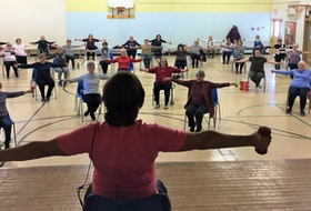 The first half of classes are done from a seated position where the second half, participants stand but still use their chairs for support.