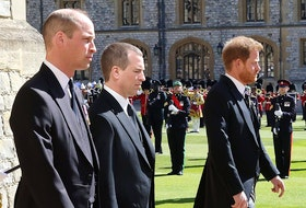 Prince Harry, Duke of Sussex (foreground), and other Royals, follow Prince Philip, Duke of Edinburgh's coffin during the Ceremonial Procession during the funeral of Prince Philip, Duke of Edinburgh at Windsor Castle on April 17, 2021 in Windsor, England.