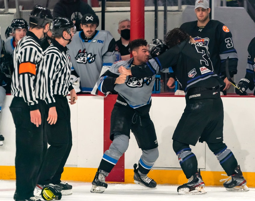 Cole Reginato of the Huntsville Havoc, left, drops the gloves with Kenton Helgesen of the Knoxville Ice Bears during recent Southern Professional Hockey League action in Huntsville, Ala. CONTRIBUTED • HUNTSVILLE HAVOC