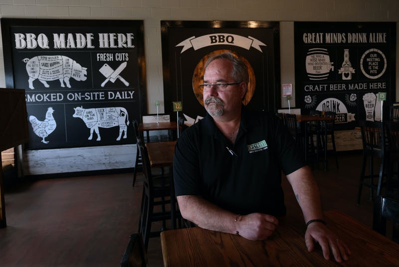 Restaurateur and chef, Bill Pratt sits one of his establishments, the Upstreet BBQ Brewhouse, in Dartmouth on Thursday. - Tim Krochak
