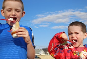 Tyler Davies, left, and Michael Davies enjoying an ice cream at Sunny's Dairy Bar, in Summerside, P.E.I.