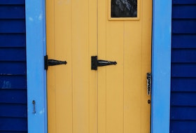 "Gary Mitchell sent this photo of an eye-catching, old-time stormdoor on Jellybean Row in St John's, N.L. He says the design allows the door to be open halfway when the weather is ""Not Fit or The Pitts.""