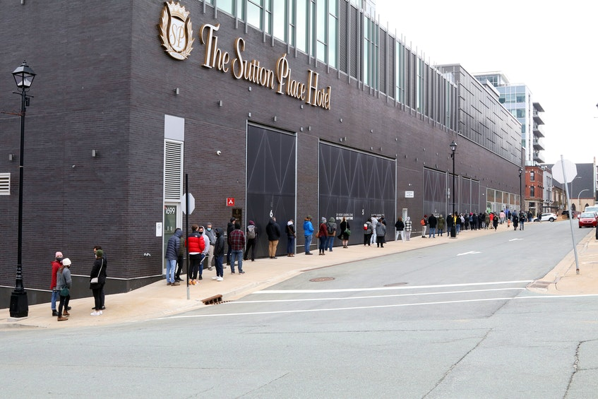 The lineup for asymptomatic testing at the Halifax Convention Centre started along Market Street, near Carmichael Friday. - ERIC WYNNE/CHRONICLE HERALD