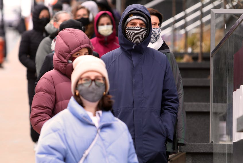 Nova Scotians lined up and masked up for asymptomatic testing at the Halifax Convention Centre Friday. Mask wearing is one of the many measures that is being strongly recommended to prevent the spread of COVID-19.