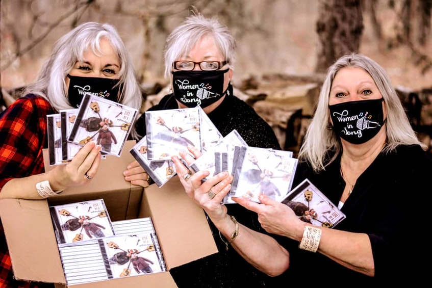 Women in Song members Patty Dunlop (left), Lois O'Hanley-Jones and Debbie Rivard displaying the CD Life of a Woman, which contains the Memories of Truro single. - Contributed