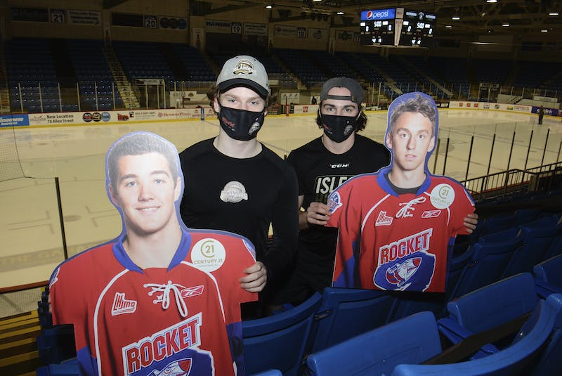 The last time two Charlottetown-based players were in the Quebec Major Junior Hockey League's top three in scoring at the end of the year the team was the P.E.I. Rocket. Charlottetown Islanders teammates Cédric Desruisseaux and Thomas Casey hold cardboard cutouts of former Rocket players Josh Currie and Ben Duffy, who finished third and first, respectively, in 2012-13. From left are Currie, Casey, Desruisseaux and Duffy.  - Jason Malloy • The Guardian