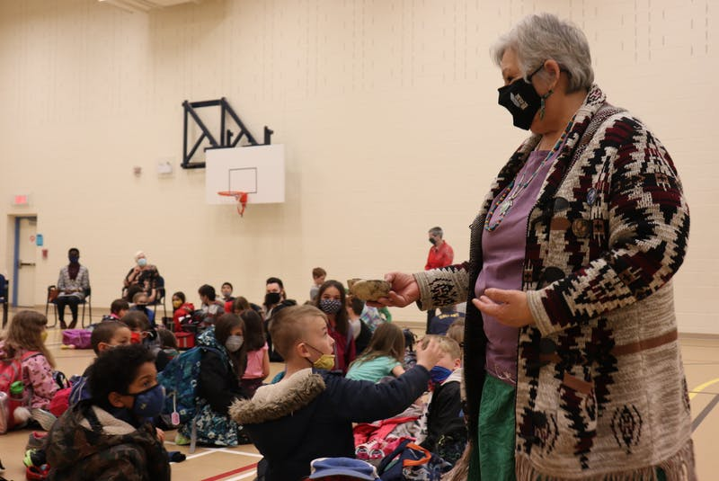 Elder Methilda Knockwood performs a smudging ceremony for students at École St. Augustine in Rustico. - Logan MacLean