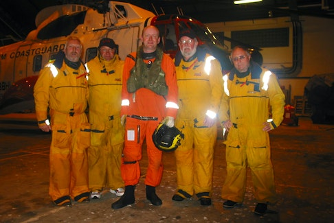 """Pictured fourth from the left is Egbert """"Eg"""" Walters after being scooped from the freezing and treacherous waters of the Atlantic Ocean after a catastrophic sea disaster. Along with his crewmates, he battled the elements for eight hours while awaiting rescue."""