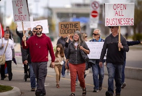 More than 100 people gathered in downtown Windsor on Saturday, April 17, 2021, to protest COVID-19 restrictions.