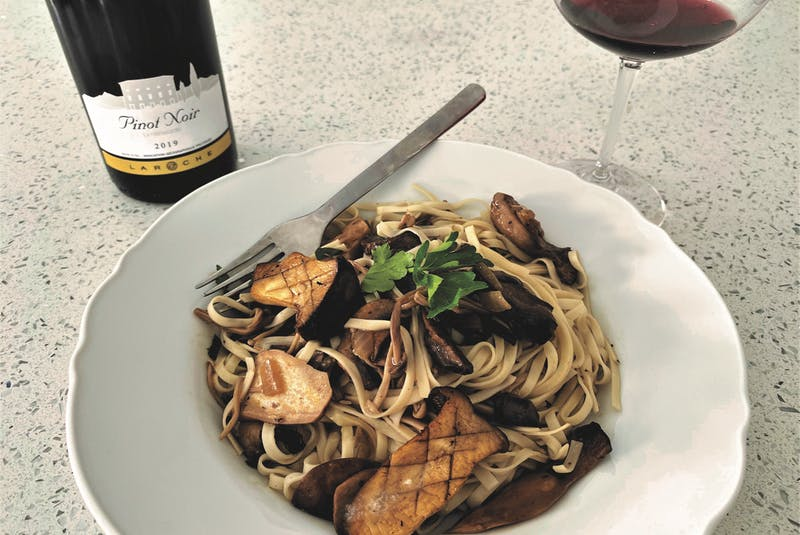 A bowl of mushrooms and egg noodles is a simple vegetarian pairing to a light-bodied pinot noir.  - Julia Webb