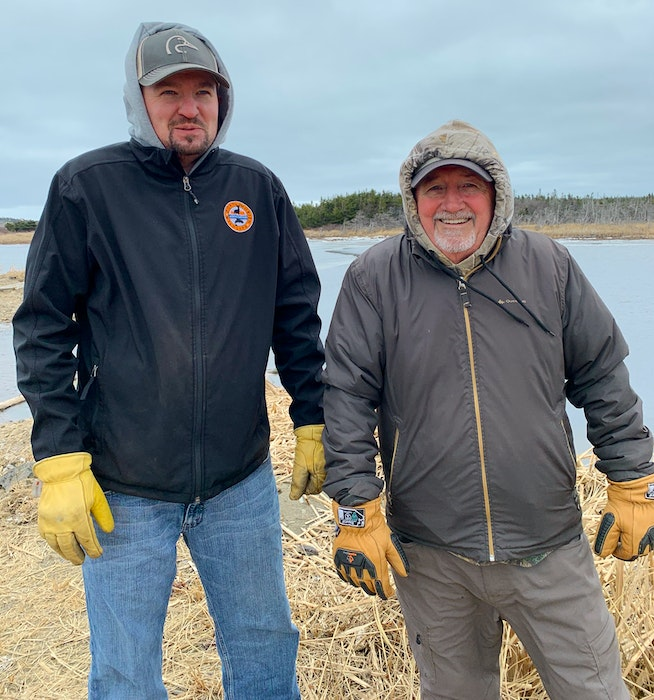 Jeff McNeil, left, president of the Port Morien Wildlife Association, and Stan Peach, treasurer, in front of Schooner Pond, where the association did restoration work on Feb. 1, 2021. JESSICA SMITH • CAPE BRETON POST - Jessica Smith