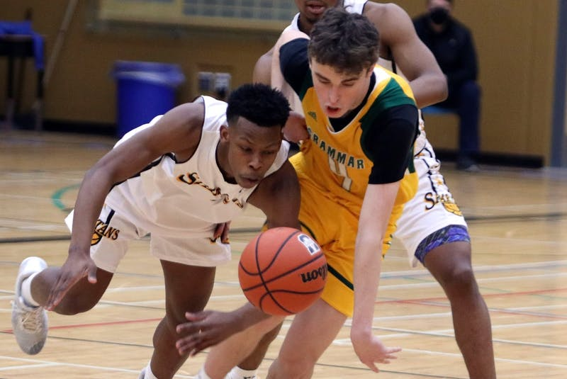 Kyle Munro of Halifax Grammar School, middle, during a Nova Scotia School Athletic Federation Capital Region Division 1 boys basketball final last week. Munro, the grandson of the late Donnie Blackwood of New Waterford, lost in the final to Dartmouth High School. SALTWIRE NETWORK - Tim Krochak