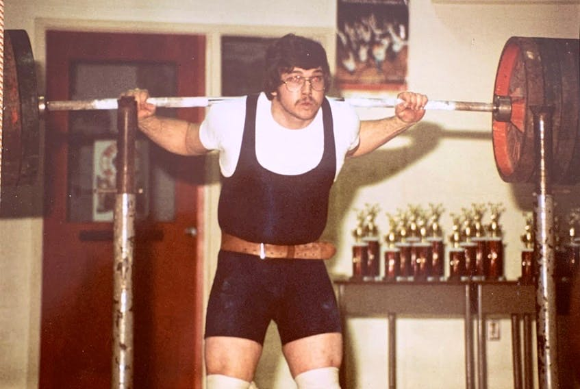 Glen Hutchison competing in a powerlifting event in the early years of his 45-year career in the sport. The New Waterford native died on Tuesday after a battle with cancer. CONTRIBUTED