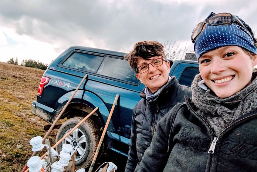 Dr. Julia Wheeler and AAFC technician Dena Wiseman conducting research in northern Canada. Wheeler is one of the researchers involved in a study looking at the use of low tunnels and bioplastic mulches in the north.