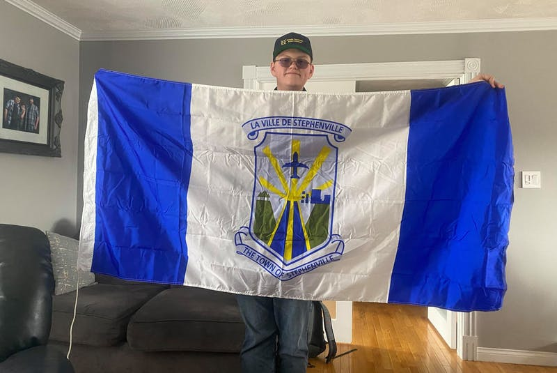 Rayden Connolly counts 45 different flags in his collection that he can fly on his flagpole in Marystown, including this one for the Town of Stephenville. — Contributed