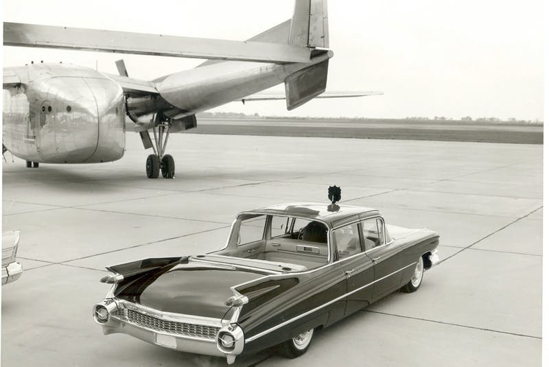 """The 1959 75 Series Cadillac Fleetwood limousine sits beneath the RCAF C-119 """"Flying Boxcar"""" used to move it around Canada for Queen Elizabeth II and Prince Philip's Royal Tour. Courtesy of the Jean-Michel Roux collection - POSTMEDIA"""