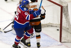 Edmonton Oil Kings forward Jake Neighbours celebrates a goal against Medicine Hat Tigers goalie Garin Bjorklund on Thursday, April 22, 2021, in Edmonton.