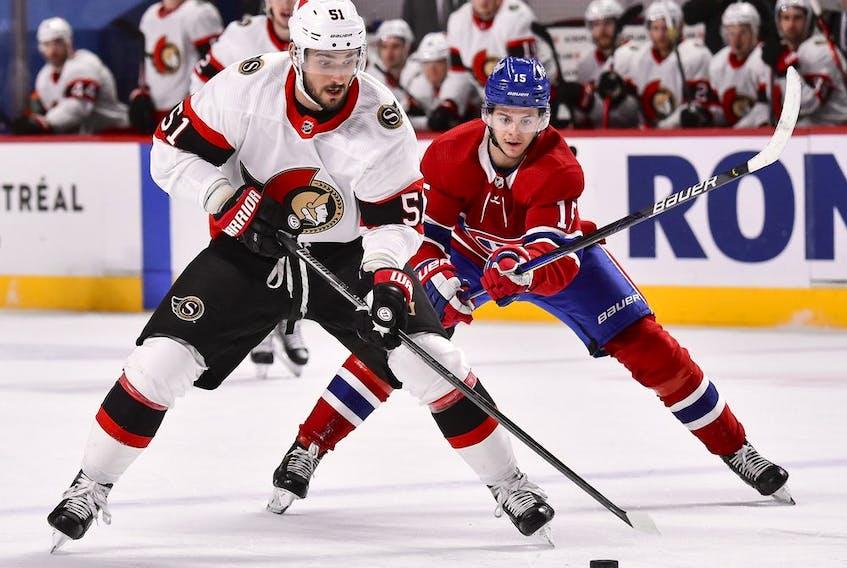 Artem Anisimov of the Senators skates the puck against Jesperi Kotkaniemi of the Canadiens during the third period, March 2, 2021.
