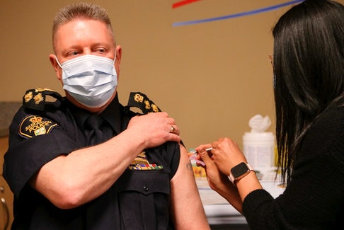 Saskatoon Police Chief Troy Cooper receives his first COVID-19 immunization at the STC clinic at SaskTel Centre. Photo taken in Saskatoon on Wednesday April 21, 2021.