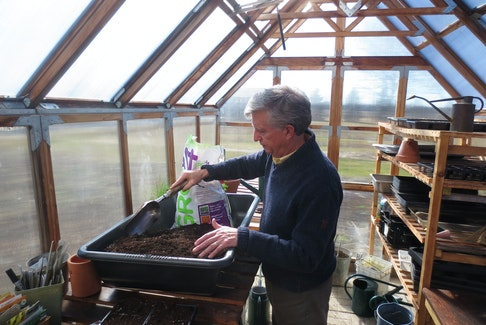 Mark Cullen enjoys getting soil ready for container gardening.