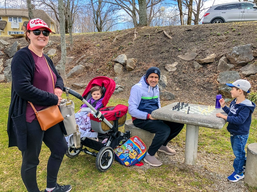 Katie Burns, left, and her husband Amit Khanna, with their daughter Remi, second left, and their son Rowan, far right, at Wentworth Park in Sydney, N.S. JESSICA SMITH/CAPE BRETON POST