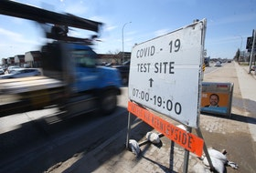 Vehicles pass a sign for a Covid-19 test site, in Winnipeg.   Wednesday, April 21, 2/2021.Winnipeg Sun/Chris Procaylo/stf