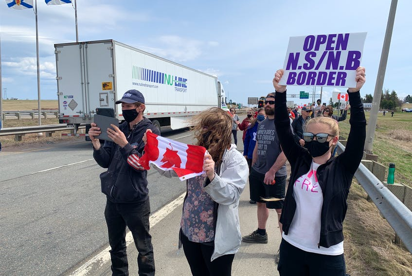 Protesters hold up signs at the entrance to Nova Scotia during a rally at the border in Fort Lawrence, N.S. Darrell Cole - SaltWire Network