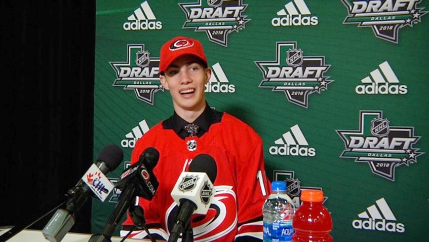 Luke Henman speaks to the media after being drafted by the Carolina Hurricanes in 2018. - CHL