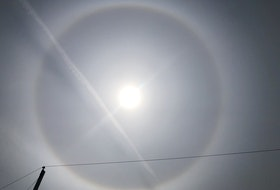 """Last Sunday, Tom Hart was out in his driveway in Dartmouth, N.S., when he spotted this beautiful halo with a contrail cutting across it. The photo was taken in the afternoon, and the high cirrus cloud acted like a filter, serving up a spectacular view of the sun.   This pretty picture also tells a story, Tom. Grandma Says: """"ring around the sun or moon, rain or snow upon you soon,"""" and it sure did!"""