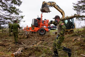 Members of the Maritime Explosive Ordnance Disposal (MEOD) Team from Fleet Diving Unit (Atlantic) work to remove a 500 lb UXO from the Second World War in the vicinity of Chebogue, Yarmouth County. Part of this included  making access to the site, which is a pond.  PHOTO:  Master Corporal Ian Thompson, Canadian Armed Forces