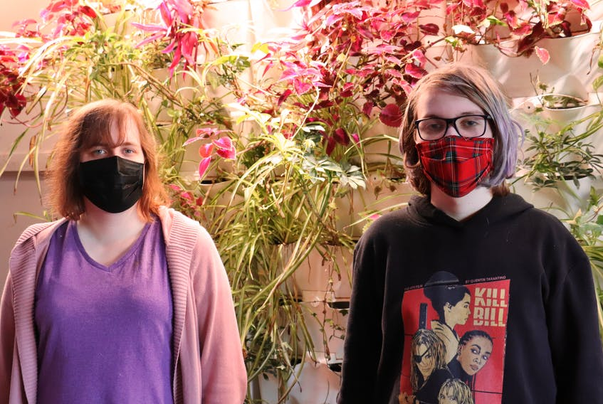 Noelle Valentine, left, and Gwen Chaisson were participants in a table-top role-playing game for queer youth organized by the Sierra Club Wild Child program. Logan MacLean • The Guardian