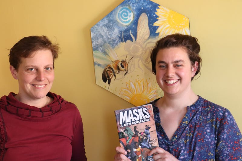Josie Baker, left, and Hannah Gehrels organized an event for queer Island youth to play Masks: A New Generation. Logan MacLean • The Guardian - Logan MacLean