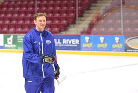 Summerside D. Alex MacDonald Ford Western Capitals assistant coach Jason Gallant is all smiles during a practice at Eastlink Arena earlier this season. Gallant, who will remain with the Caps through their playoff run in the Maritime Junior Hockey League (MHL), has been appointed head coach of the Kensington Monaghan Farms Wild major under-18 program.