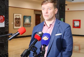 Premier Andrew Furey speaks with members of the media Monday about the first team of Newfoundland and Labrador medical professionals heading to Ontario today. Glen Whiffen/SaltWire Network
