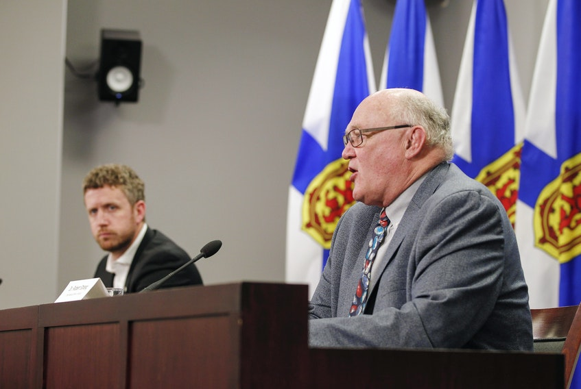 Premier Iain Rankin, left, looks on as Dr. Robert Strang, Nova Scotia's chief medical officer of health, gives an update on Nova Scotia's COVID-19 situation on Monday, April 26, 2021.