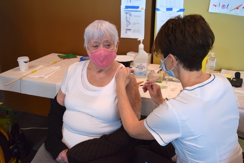 Louella Mackenzie receives her first dose of the Pfizer-BioNTech COVID vaccine during the first week of clinics for people over 80 at the NSCC in Truro.