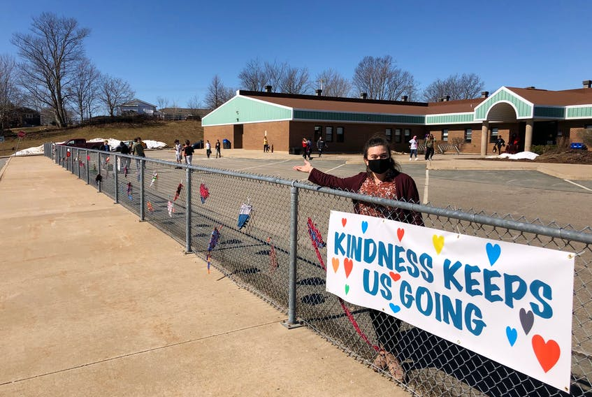 Sixty students wove these hearts lining the fence of Evangeline Middle School. Teacher Sandra Bornemann drew inspiration from kindness initiatives other teachers and staff had led at the school. - Contributed
