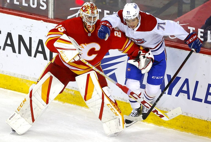 Calgary Flames goalie Jacob Markstrom battles Montreal Canadiens Jake Evans in third period NHL action at the Scotiabank Saddledome in Calgary on Monday, April 26, 2021. Darren Makowichuk/Postmedia
