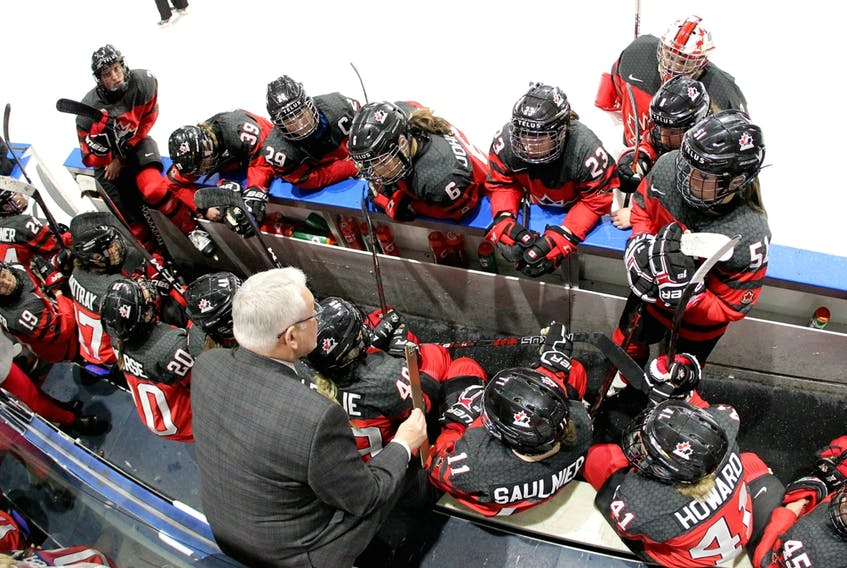 Canada players listen as coach Perry Pearn gives directions in the National Women's Team Rivalry Series in London, Ont., in this file photo from Feb. 12, 2019.