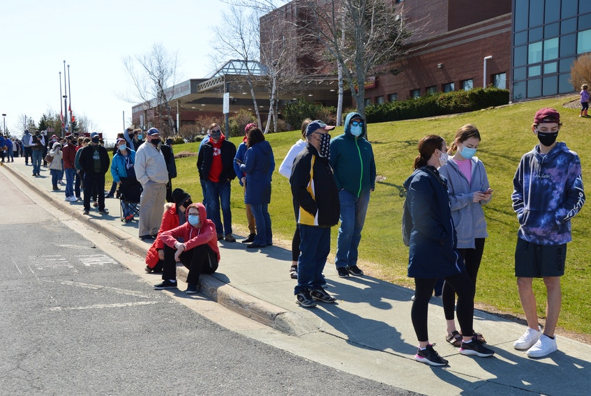 Hundreds line up at the Cape Breton Regional Hospital on Sunday to get a COVID-19 assessment, sparked by a recent surge in exposures at several locations. IAN NATHANSON/CAPE BRETON POST