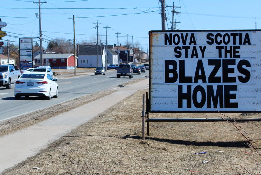 """People driving along Reserve Street in Glace Bay are reminded to """"Stay the blazes home"""", thanks to this sign. Since Nova Scotia Premier Stephen McNeil first said it during a daily press conference COVID-19 update, the phrase has become a viral sensation with memes, mugs and t-shirts. NICOLE SULLIVAN/CAPE BRETON POST"""