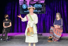"""Allison Kelly performs a segment from the play """"What is She Wearing"""" Tuesday during an event held at Canadian AV facility in St. John's and hosted by the PerSIStence Theatre Company to commemorate the 100th anniversary of property-owning women obtaining the right to vote in municipal elections."""