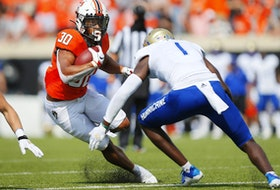 Running back Chuba Hubbard #30 of the Oklahoma State should be taken in the NFL draft over the next few days.