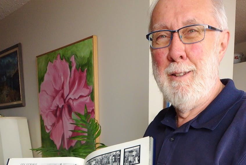 Dan O'Connor displays is St. F.X. yearbook from 1971.